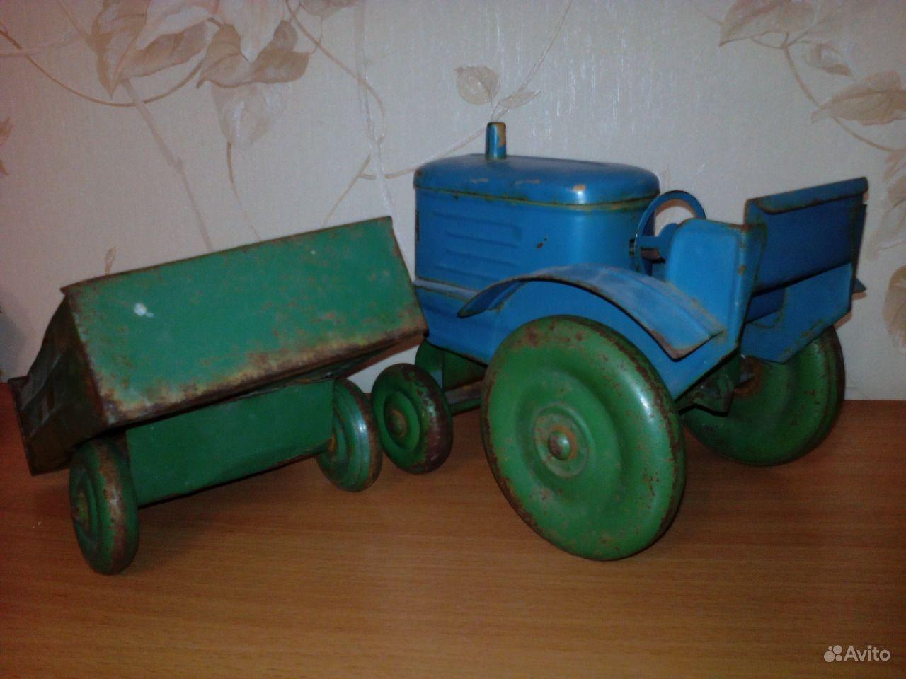 оформлении трактор с прицепом игрушка ссср фото вызывает как